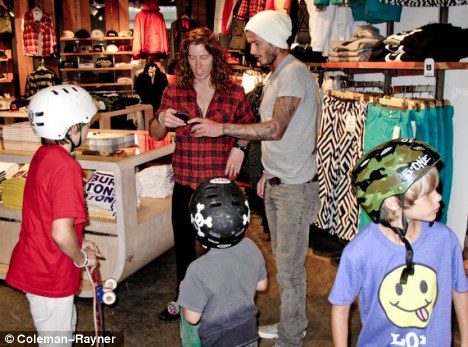 Skate fans: Brooklyn, Romeo and Cruz tried on helmets and tried out skateboard in the store as they met White