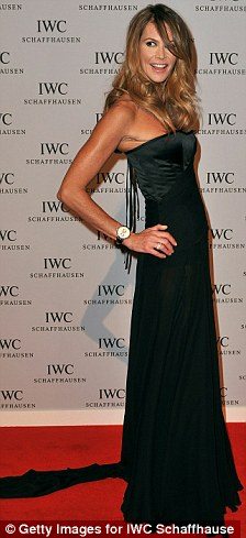 Back in black: Elle was wearing an elegant strapless black floor length gown with a corset back and black satin sandals