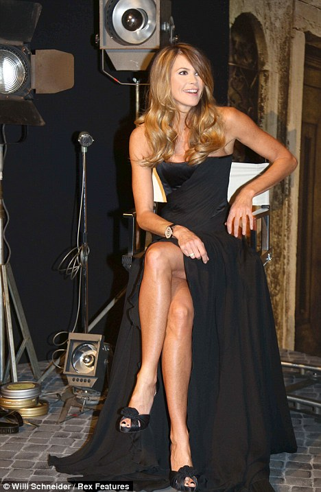 Time for a rest? Elle Macpherson has a brief sitdown at the launch party