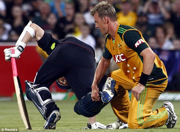 This didn't help: Australia's Brett Lee grabs  Graeme Swann's leg during their Twenty20 clash