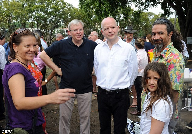 Diplomatic visit: British Foreign Secretary William Hague (centre-right) and his Australian counterpart Kevin Rudd (centre-left) meet victims of Queensland's devastating floods