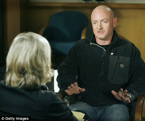Supportive: Mark Kelly has spoken to ABC's Diane Sawyer in his first interview since the gun massacre two weeks ago that left his wife Gabrielle Giffords with a gunshot wound to the head