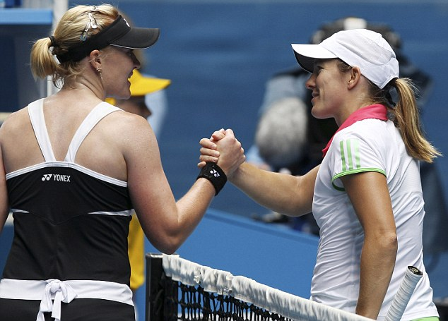 It's over: Justine Henin (right) shakes hands with Elena Baltacha