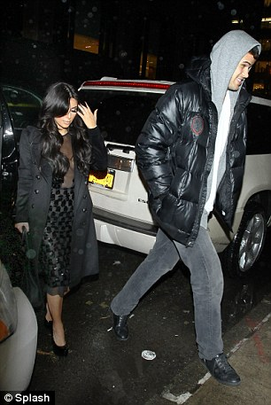 New love: Kim is accompanied to dinner by her new boyfriend, New Jersey Nets basketball player Kris Humphries, who towered above his reality TV star lady