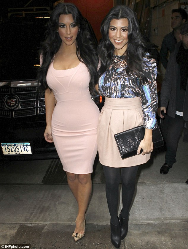 Sister act: The pair wore matching blush, with Kim in a dress and Kourtney in a skirt