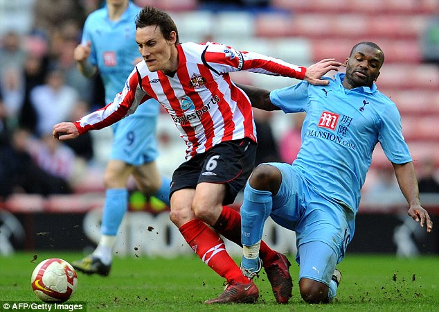 Unhappy days: Bent (right) in action for Tottenham against Sunderland in 2009