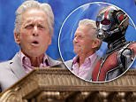 """NEW YORK, NY - JULY 13:  Michael Douglas and Marvel Entertainment executives to ring the New York Stock Exchange closing bell to promote """"Ant-Man"""" at New York Stock Exchange on July 13, 2015 in New York City.  (Photo by John Lamparski/WireImage)"""