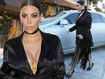 Pregnant Kim Kardashian looking dramatic at Craig's  in black and fringe arriving at dinner. July 13, 2015 X17online.com
