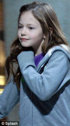 Rising star: Twilight's new recruit Mackenzie Foy signed autographs as she arrived into Vancouver, Canada, today