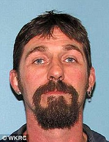 Sam Littleton was charged in absentia with murder Friday, Feb. 18, 2011