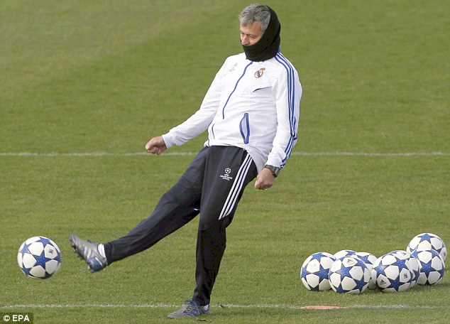 The Real deal: Jose Mourinho in training ahead of the Champions League clash with Lyon
