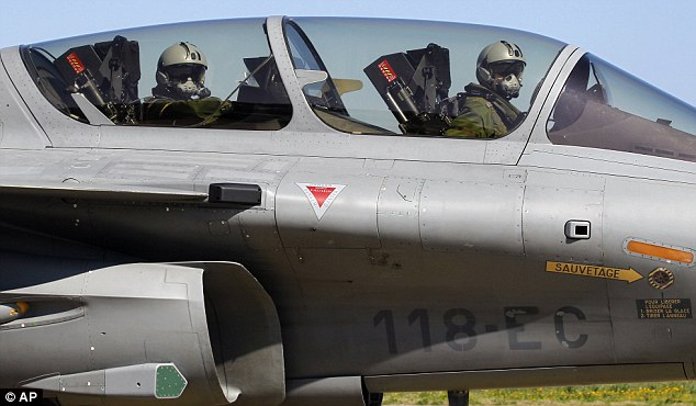 Top guns: French Air Force pilots in a Rafale jet fighter return to base on Corsica after a mission to Libya