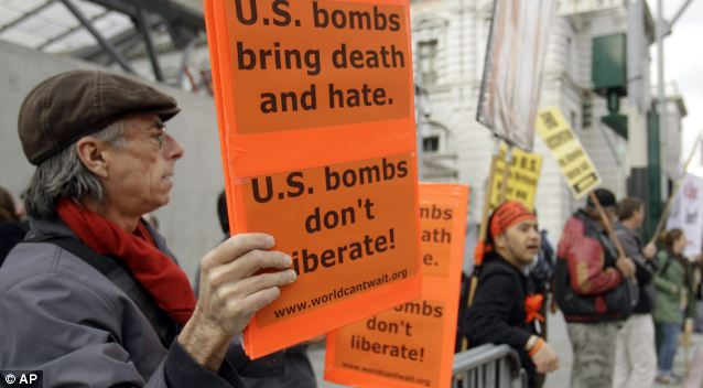Demo: Protesters in San Francisco raise placards demonstrating against U.S. military intervention against Gaddafi