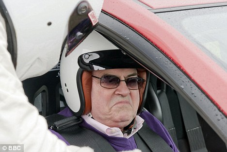 Mr Glum: Prezza gets from tips from The Stig at the wheel
