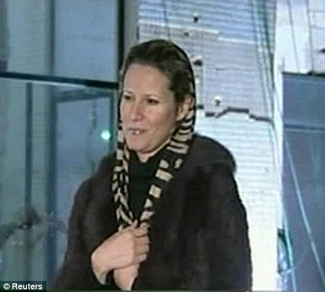 Libyan leader Muammar Gaddafi's daughter Aisha speaks during an interview on state television, in this still image taken from video broadcast February 24, 2011.