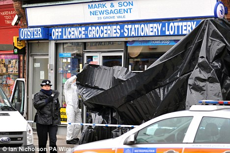 Crime scene: Forensics officers put up tarpaulin in East Dulwich where the teenager was stabbed