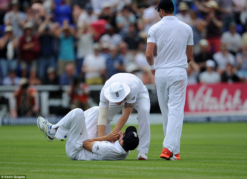 Cook is congratulated by Ben Stokes and James Anderson after his magnificent catch to remove Haddin of Australia