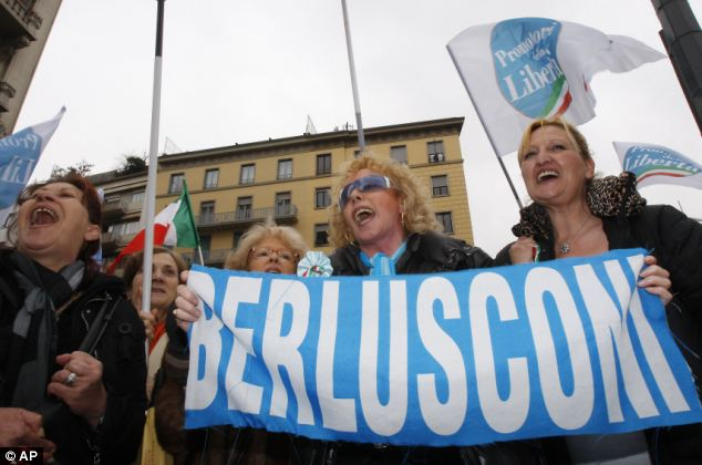 In the Silvio camp: Supporters of the embattled Berlusconi cheer him over the tax fraud case that he dismissed as groundless and ridiculous