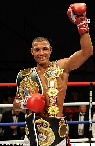 The champ: Kell Brook celebrates with his new WBA belt