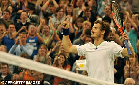 Murray's mint: Andy Murray celebrates his third-round victory
