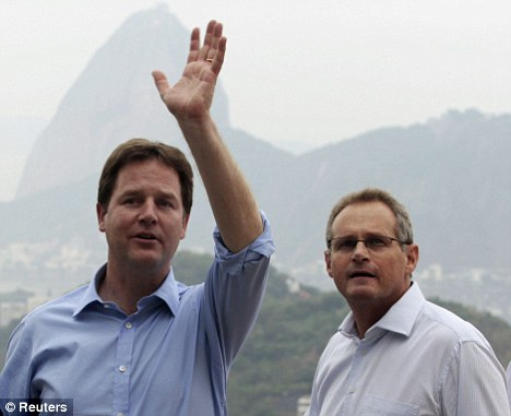 No expense spared: Britain's Deputy Prime Minister Nick Clegg (left) with Rio de Janeiro's State Security Secretary Jose Mariano Beltrame during a visit to Prazeres slum in Rio this week