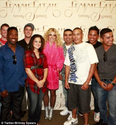Honoured: Britney Spears posed for pictures with a group of U.S. Marines and she tweeted this photo