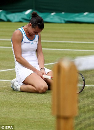 Flavia Pennetta of Italy reacts after losing her third round match against Marion Bartoli of France