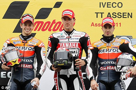 Scond place Casey Stoner of Australia, left, first place Ben Spies of the US, center, and third place Andrea Dovizioso of Italy
