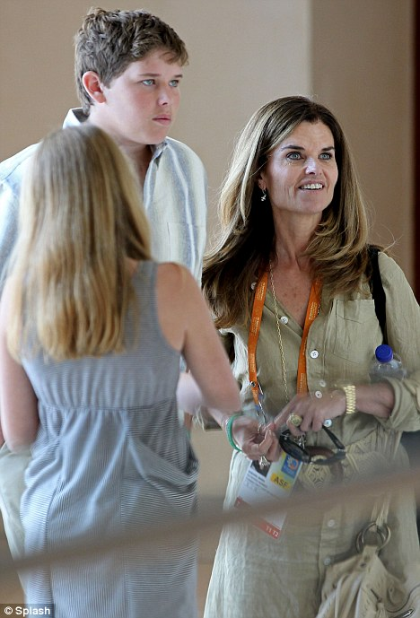 Glad to get away: A smiling Maria Shriver, her youngest son Christopher and another family member arrived at the Hilton Hotel in Athens, Greece today