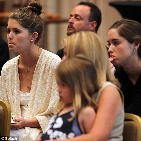 Focused: Maria's family, including daughter Katherine  (wearing white) listen intently during a news conference about the Special Olympics