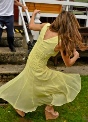Hit for six: Liz fell victim of her towering heels and clutched onto railings as she attempted to stay upright after cutting the ribbon to declare the fete open