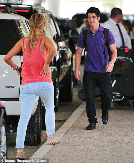 There you are: Nick looked delighted to see his new lady as he met her outside the airport
