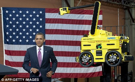Workers of the future: President Barack Obama after touring the National Robotics Engineering Center at Carnegie Mellon University in Pittsburgh, Pennsylvania yesterday