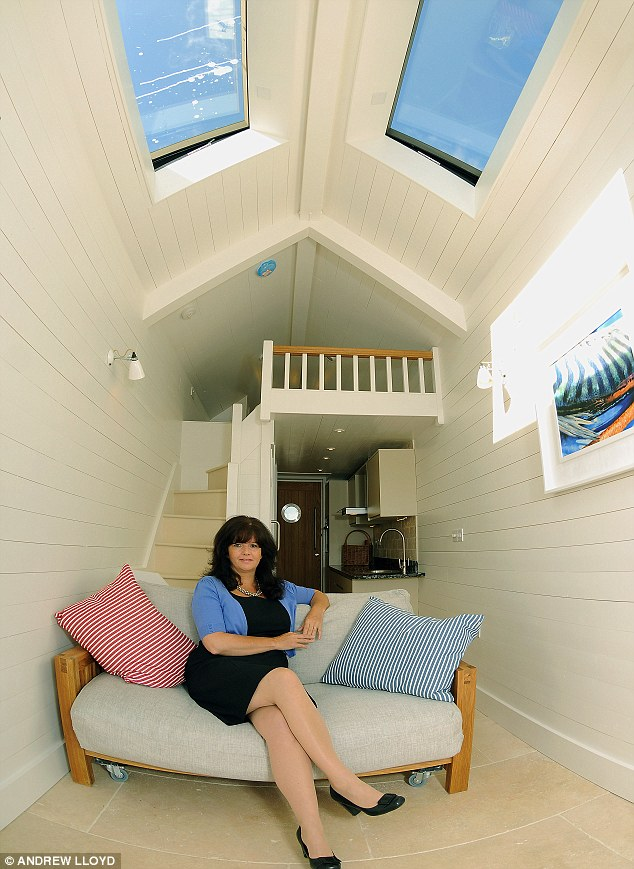 Cosy: The 23ft by 6ft beach hut can sleep four and has a fitted kitchen with granite worktops