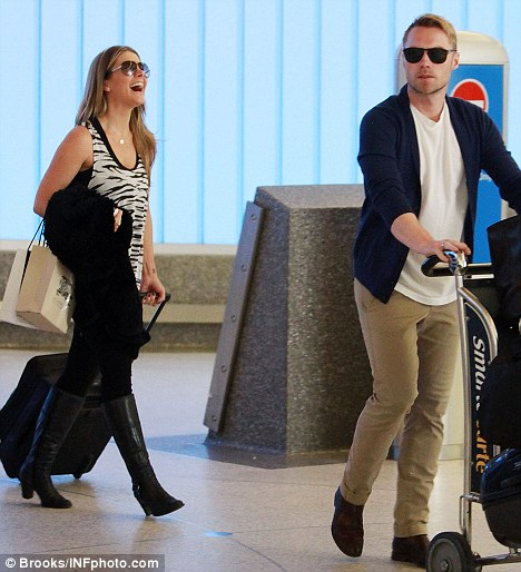 Something funny, Natalie? Bassingthwaighte laughs out loud as she and Ronan Keating arrive in Los Angeles