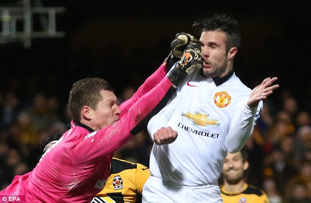 The striker gets a painful blow to head from Cambridge United keeper Chris Dunn in an FA Cup tie