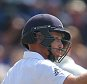 Ian Bell of England celebrates scoring his half century on day three of the first Ashes test