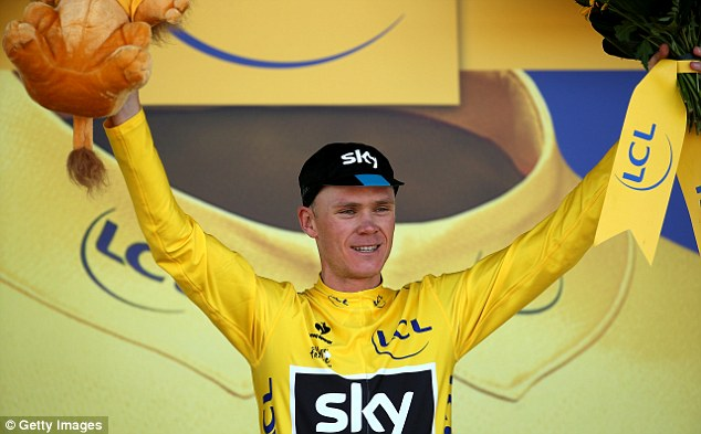 Chris Froome of Great Britain and Team Sky celebrates as he retains the overall lead and  yellow jersey