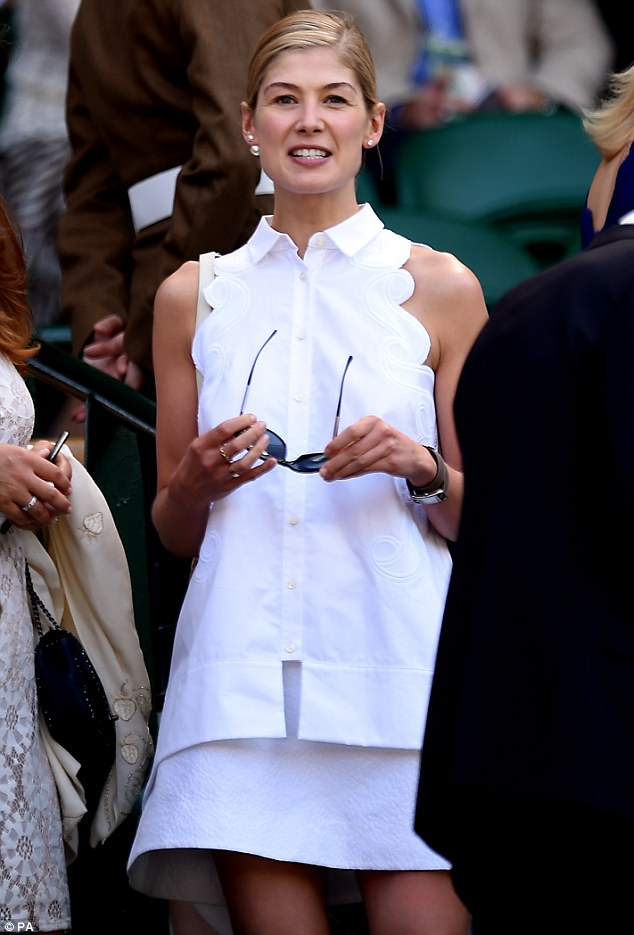 Shades off: To see when the sun went in, the elegant actress removed her oversized shades