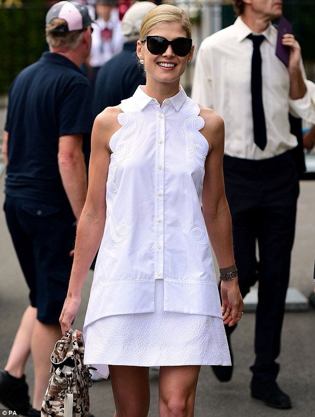 Killer smile: With simple white mules, a camouflage mini ruck-sack and large dark glasses the star looked casual yet classy as she headed to centre court to soak up the game
