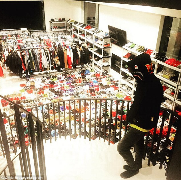 Closet connoisseur: Chris Brown, 26, took to Instagram on Thursday to show off his massive walk-in closet at his new home i the San Fernando valley