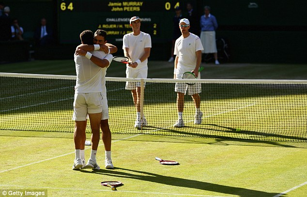 Jean-Julien Rojer and Horia Tecau hug each other in celebration after their victory