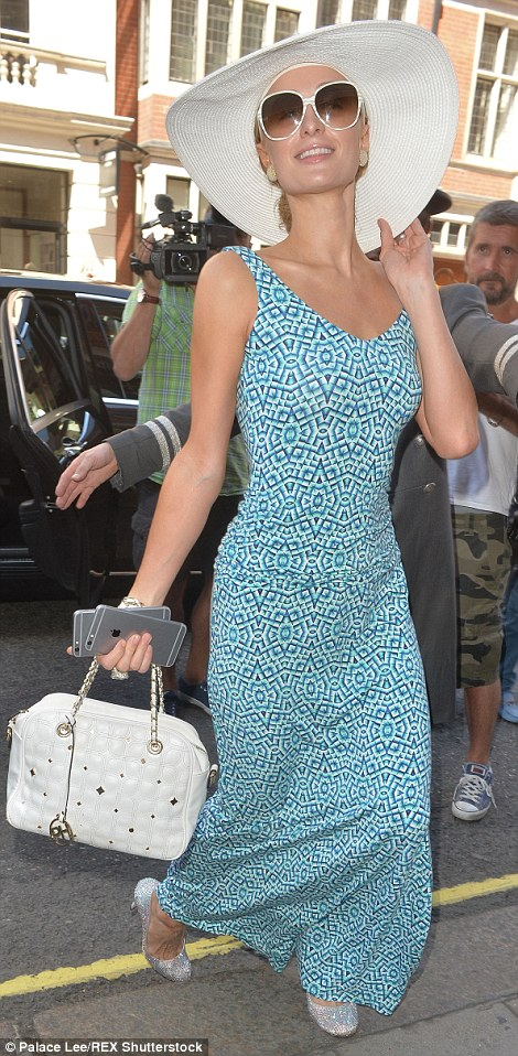 Looking good: Miss Hilton, 35, wore a blue maxi dress, a pair of glittery heels and a huge picture hat