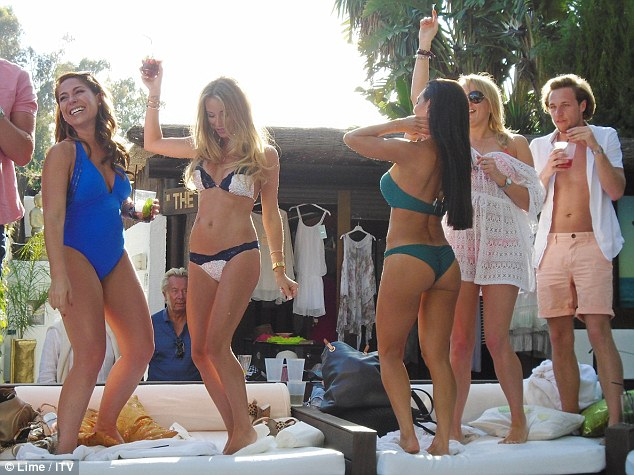 Tanned, toned and ready for trouble: The girls look like they know how to party as they dance on the sofas at one of their many exclusive spots