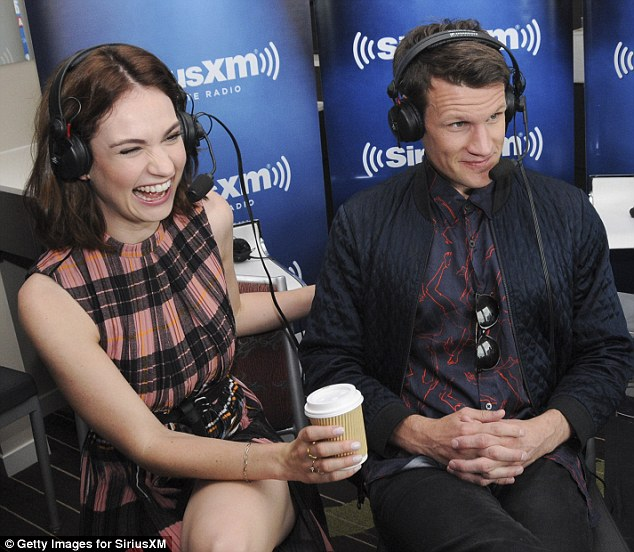 Something is funny:The couple, who are thought to have started dating last October, could barely keep their hands off each other as they chatted on radio at Comic-Con International 2015
