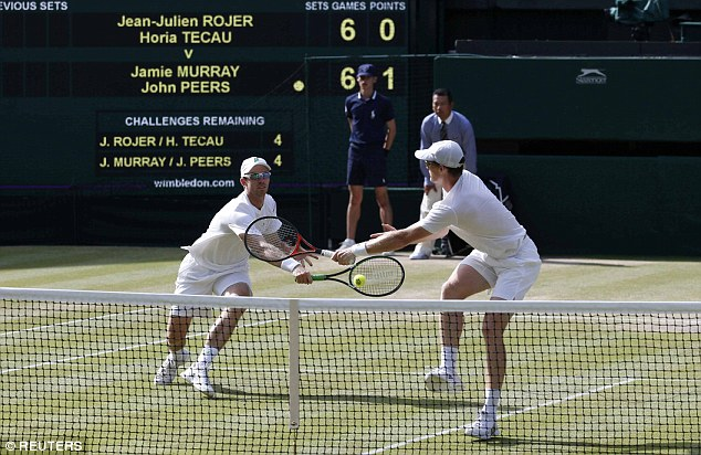 Peers (left) and Murray (right) both go for the same ball during the first set tie-break