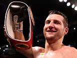 Carl Froch celebrates with his belts after knocking down George Groves during the IBF and WBA World Super Middleweight Title fight at Wembley Stadium, London, England.   PRESS ASSOCIATION Photo. Picture date: Saturday May 31, 2014. See PA story BOXING London. Photo credit should read: Peter Byrne/PA Wire