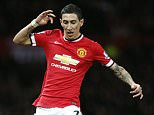 Manchester Unitedís Angel Di Maria runs with the ball during the English FA Cup quarterfinal soccer match between Manchester United and Arsenal at Old Trafford Stadium, Manchester, England on March 9, 2015.    (AP Photo/Jon Super)
