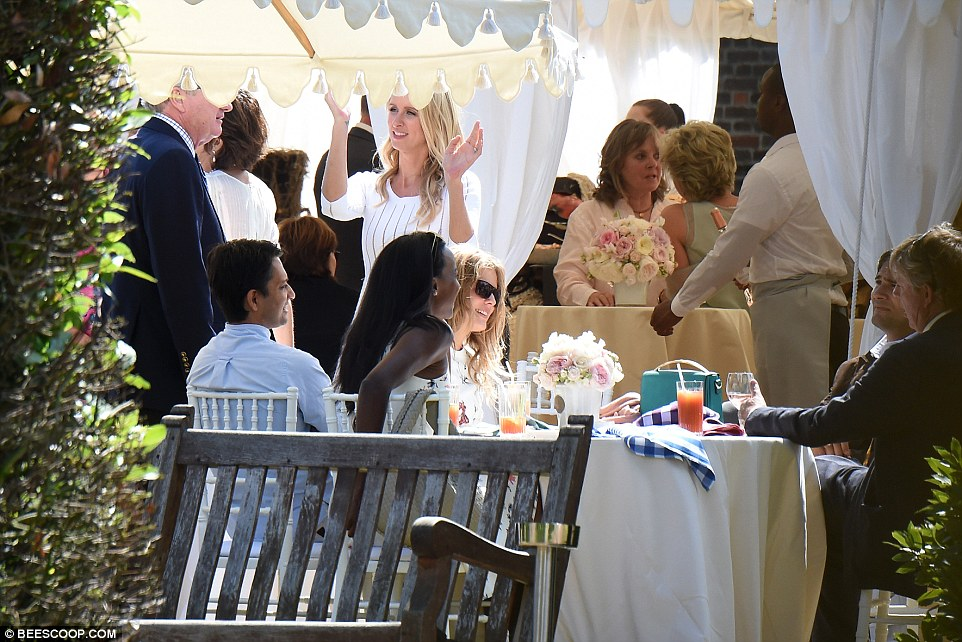 Time to dance? Nicky Hilton seems to be getting into the swing of things at the post-wedding luncheon, but everyone else looks quite happy sitting down