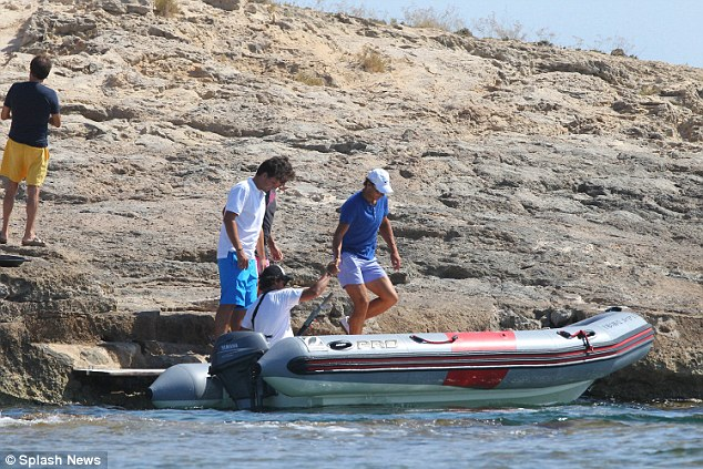 Setting sail: Nadal is first to board the boat and is given a helping hand by the driver